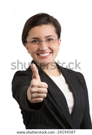 Businesswoman giving thumbs up for approval, DOF focus on hand - stock photo