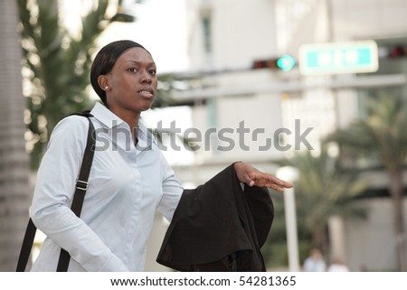 Businesswoman hailing a taxi cab