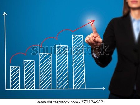 Businesswoman hand drawing growth graph on visual screen. Isolated on blue. Women finger on graph.  Business, internet, technology concept. Stock Image