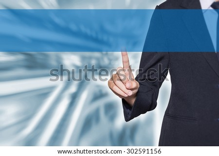 Businesswoman hand pointing on virtual screen with blur shopping mall for business background concept (free blank space for montage your text) - stock photo