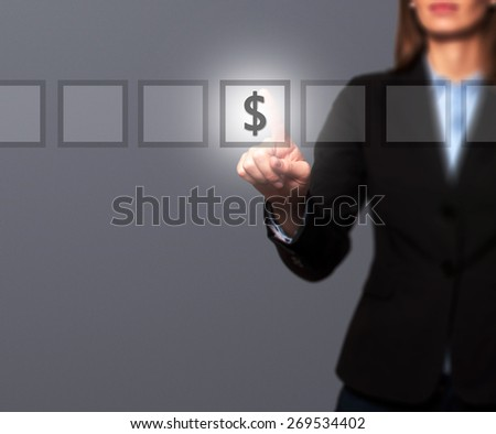 Businesswoman hand press dollar icon button on visual screen. Women finger on dollar icon. Isolated on grey. Business, technology, internet concept. Stock Image - stock photo