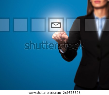 Businesswoman hand press mail icon button on visual screen. Women finger on mail icon. Isolated on blue. Business, technology, internet concept. Stock Image - stock photo