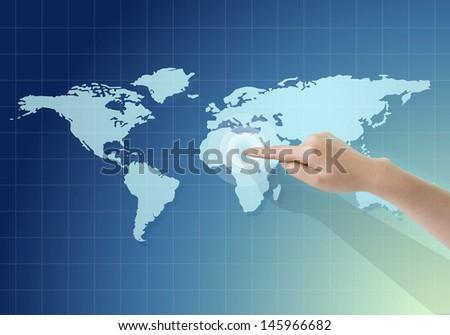 businesswoman hand touching world map - stock photo