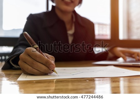 businesswoman hand working with new laptop and writing on the notepad, Business concept, vintage tone, soft focus