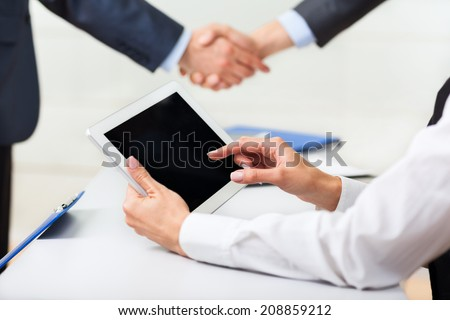 businesswoman hands touching digital tablet empty screen copy space, business woman using computer, female point finger touch pad at office desk, businessman handshake during meeting