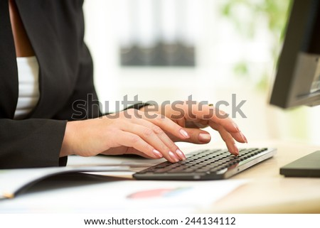 businesswoman hands typing documents on keyboard of computer - stock photo