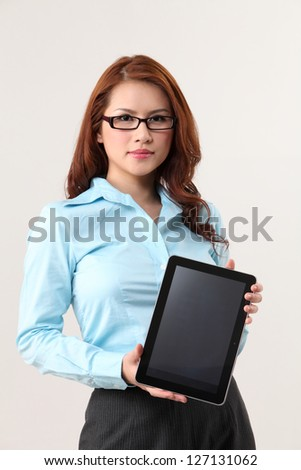businesswoman has a tablet - stock photo
