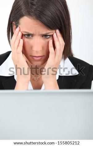 Businesswoman having computer problems - stock photo