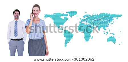 Businesswoman having phone call while her colleague posing against world map - stock photo