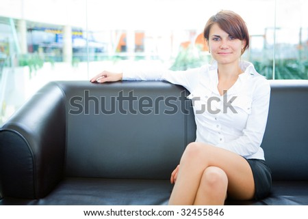 businesswoman head of business sit on skin sofa