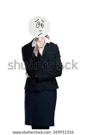 Businesswoman hiding her face behind round banner with sad smiley - stock photo