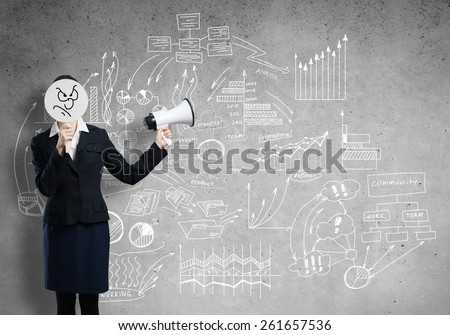 Businesswoman hiding her face behind round mask