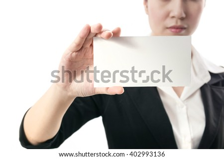 Businesswoman holding a blank card - stock photo