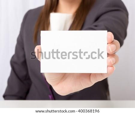 Businesswoman holding a blank card,focus blank card. - stock photo