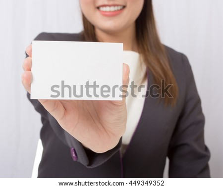 Businesswoman holding a blank card,focus blank card. - stock photo