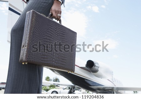 Businesswoman Holding a Briefcase - stock photo