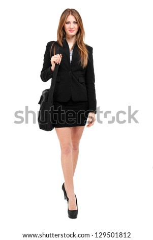 Businesswoman holding a briefcase while walking