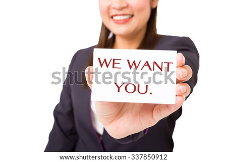 "Businesswoman holding a card with the word ""WE WANT YOU"". - stock photo"