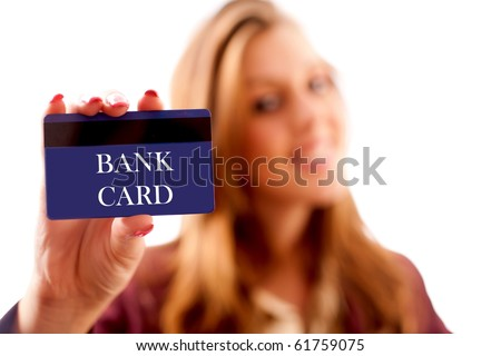 Businesswoman holding a credit card. The writing on the card can easily be replaced