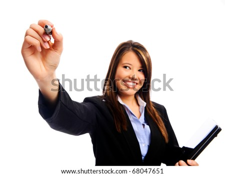 Businesswoman holding a laptop writes with a marker, selective focus on hand - stock photo