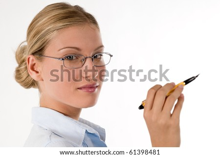 Businesswoman holding a pen and thinking, isolated on white