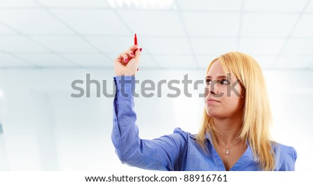 Businesswoman holding a pen while writing. Put your text there. - stock photo