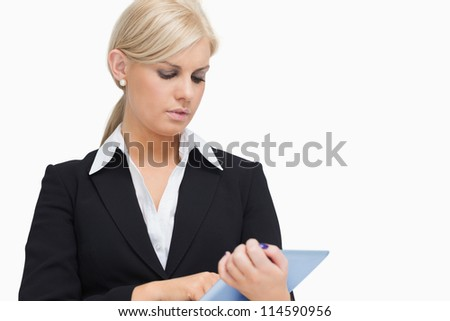 Businesswoman holding a tablet computer against white background - stock photo