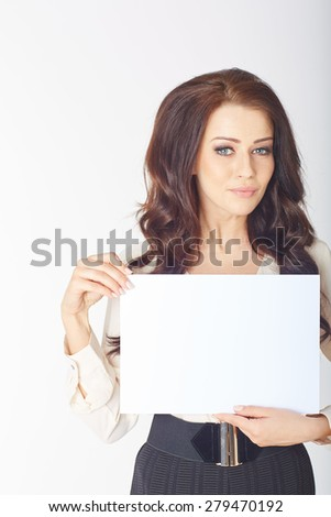 Businesswoman holding a white board in a white studio