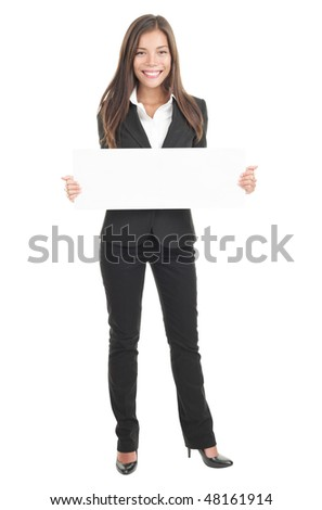 Businesswoman holding a white empty banner or poster in full length. Beautiful mixed race chinese / caucasian woman isolated on white background. - stock photo