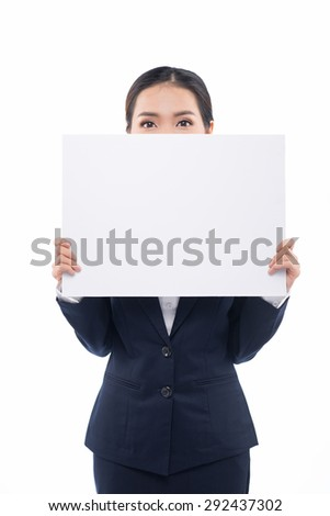 Businesswoman holding a white empty banner or poster. Sign woman surprised looking down on billboard / blank sign. Beautiful mixed race asian / caucasian model. Isolated on white background. - stock photo