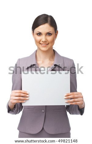 Businesswoman holding an empty billboard over white background - stock photo