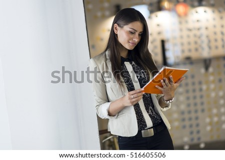 Businesswoman holding and reading document