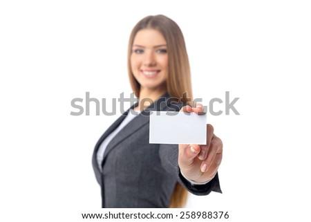 Businesswoman holding blank businesscard - stock photo