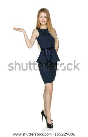 Businesswoman holding blank copy space on her open palm standing in full length, isolated on white background