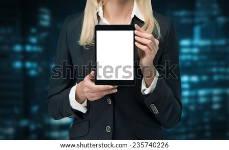 businesswoman holding blank touch pad - stock photo