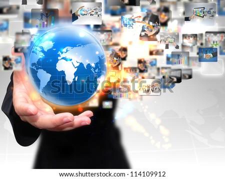 businesswoman holding business world - stock photo