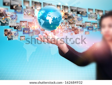businesswoman holding business world