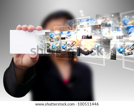Businesswoman holding card .Technology concept - stock photo