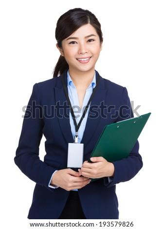 Businesswoman holding clipboard - stock photo