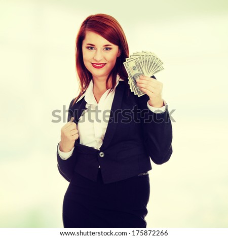 Businesswoman holding dollars - stock photo