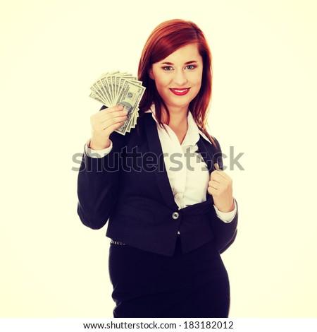 Businesswoman holding dollars - stock photo