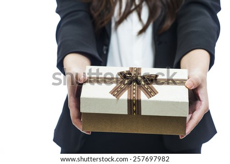 businesswoman   holding fine wrapped gift box - stock photo