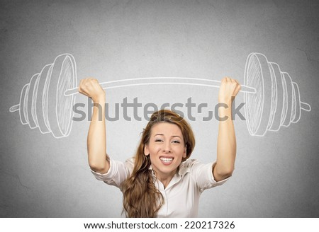 businesswoman holding hand sketched barbell, heavy weight concept achievements in business, isolated grey wall background. Human face expression, emotion determination, difficult assignment concept - stock photo