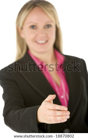 Businesswoman Holding  Her Hand Out Ready To Shake - stock photo