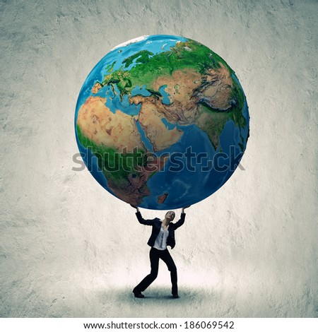 Businesswoman holding huge Earth planet above head. Elements of this image are furnished by NASA - stock photo
