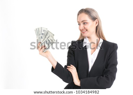 Businesswoman holding money with smile isolated on white background.