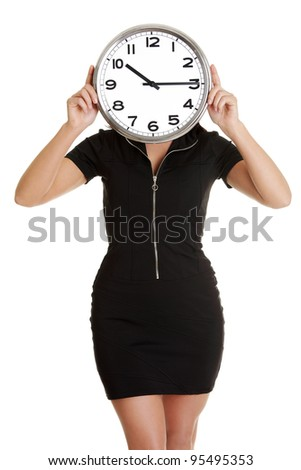 Businesswoman holding office clock, isolated on white background