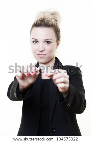 businesswoman holding out and breaking a cigarette in half symbolizing she's giving up smoking