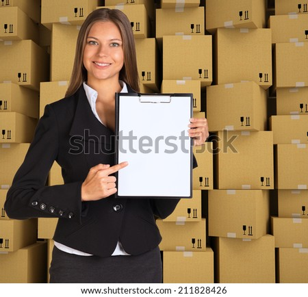 Businesswoman holding paper holder - stock photo