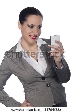 Businesswoman holding phone - stock photo
